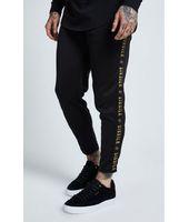 Pantalón SikSilk Cropped Gold Tape Jogger - Negro y Oro para Hombre