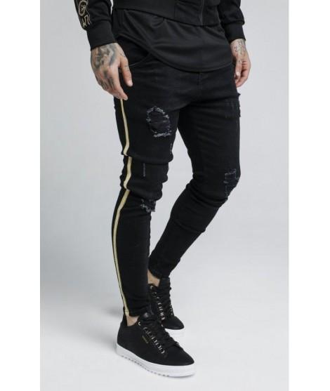 Pantalones Vaqueros Siksilk desgastados con cinta dorada